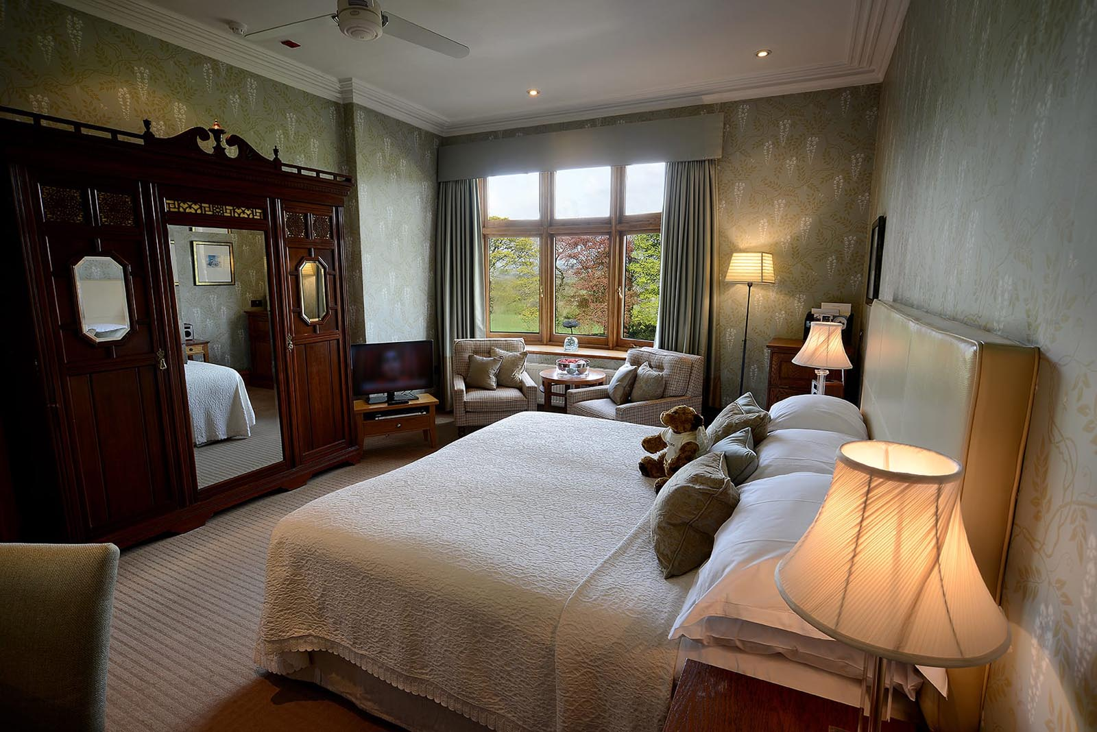 Large bed, seating area and large window